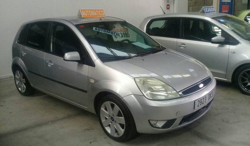 AUTOMÁTICO Ford Fiesta 1.4, año 2005, 100.000 km, música, aire acondicionado, etc., cambio automático, pidiendo 3.995e.